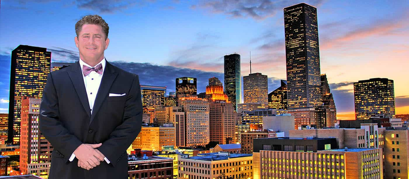 Ronald Graham standing in front of Houston skyline